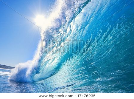 Big Blue Surfing Wave Breaks in Ocean with Sun and Clear Sky, Surfer's Perspective