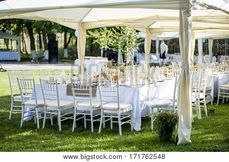 Tables, chairs and decoration during wedding party