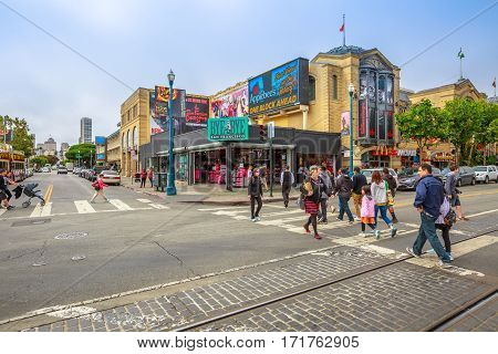 San Francisco, California, United States - August 14, 2016: People walking in Jefferson rd Mason st corner at Fisherman's Wharf district. San Francisco cityscape street view. America travel tourism