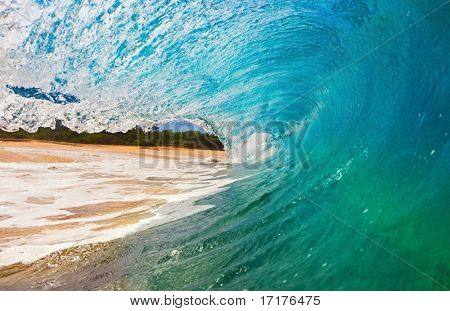 Blue Wave Breaks onto Beach, View from inside the Tube