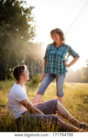 Smiling mother and son enjoying a conversation outdoors