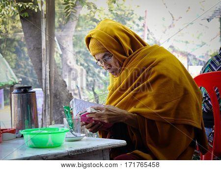 Bagan, Myanmar - Oct 1, 2016. A monk reading book in Bagan, Myanmar.