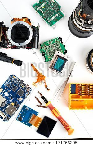Details Of Disassembled Dslr And Tools For Repair Isolated
