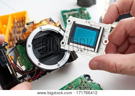 Image Sensor Digital Slr Camera In Hands Of Service Engineer