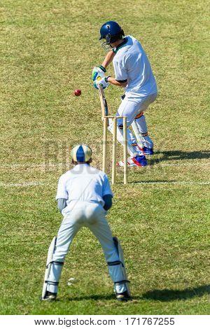 Cricket Batsman Wicket Keeper game action teenagers high schools