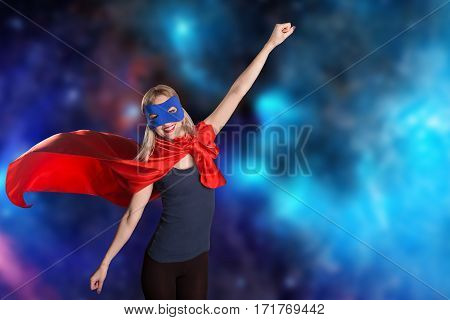 Female In Red Cape And Blue Mask On Space Background.