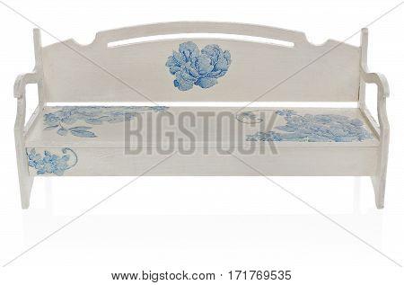 The wooden bench painted white with a pattern of blue flowers. Miniature bench toy on a white background with slight reflection.