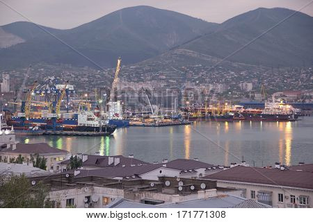 RUSSIA, NOVOROSSIYSK - MAY 8, 2015:View of Novorossiysk commercial sea port after sunset. Novorossiysk is a major sea port in Russia