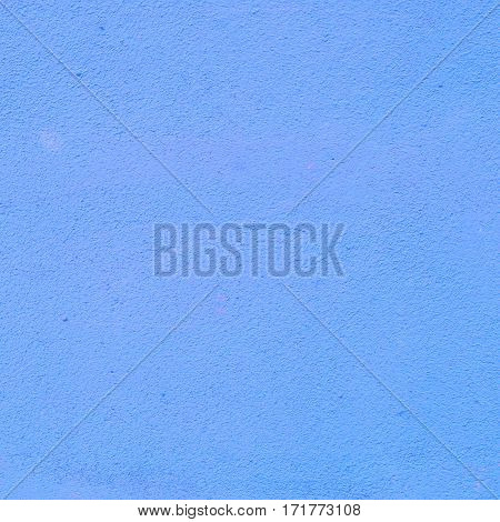 Background of a blue stucco coated and painted exterior, rough cast of cement and concrete wall texture, decorative coating