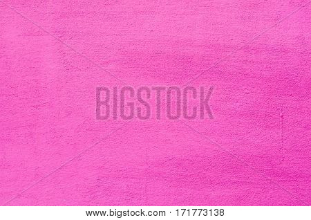 Background of a pink stucco coated and painted exterior, rough cast of cement and concrete wall texture, decorative coating