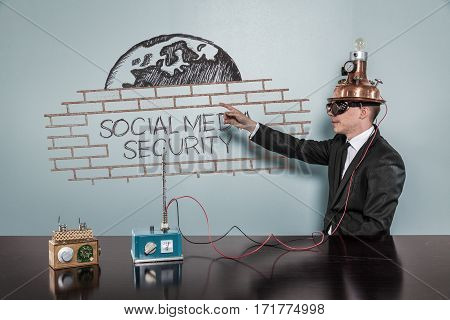 Social Media Security concept with vintage businessman pointing hand