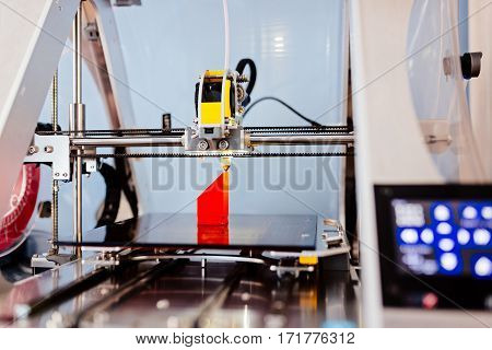 3D Printer Printing Red Plastic Component