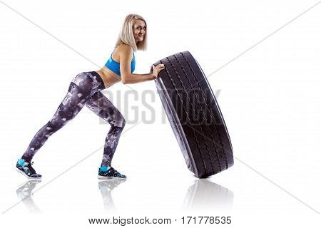 Young Fitness Woman Execute Exercise With Large Tire Casing. Isolated Over White Background.