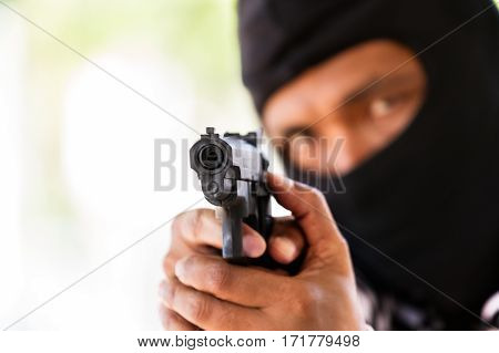 Man with gun gangster focus on the gun (robbery gun pistol)