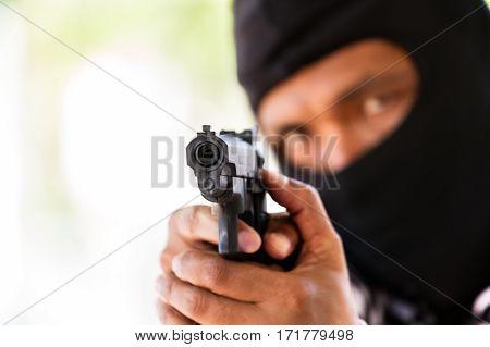 Man with gun gangster focus on the gun (robbery gun pistol)