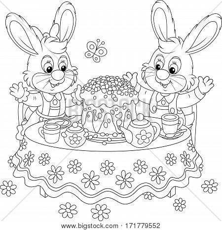 Small Easter rabbits at the tea table with a decorated holiday cake