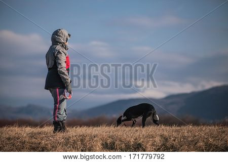 Child in nature with dog