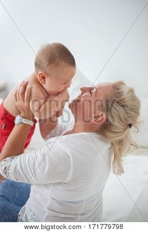 Mom with baby in home having fun