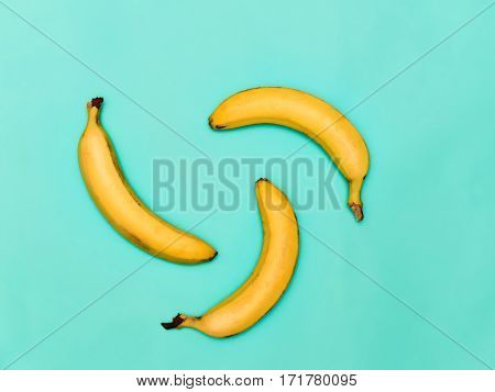 The group of fresh bananas against the blue background