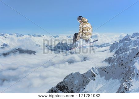 Snowboard rider jumping on mountains. Extreme sport.