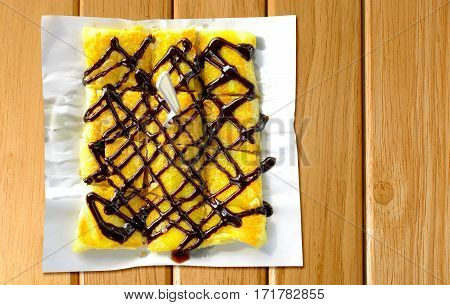 thai pancakes roti banana with chocolate on wooden board