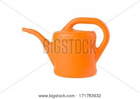 orange watering can on white background studio shot