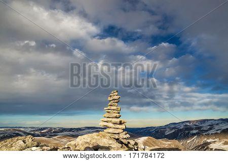Zen stones stack rock flow in the Caucasian mountains