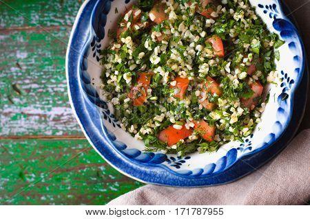 Vegetarian salad Tabbouleh with bulgur mint and parsley horizontal