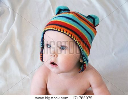 Portrait of Baby boy in multicolored knitted cap