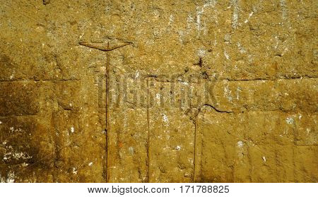 Old Corroded Concrete Wall With Stains And Metal Bars