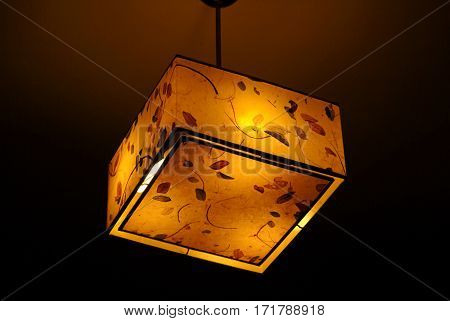 Hanging Plastic Square Ceiling Lamp With A Yellow Dim Light