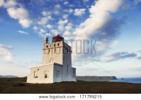 Beautiful white lighthouse at Cape Dyrholaey, South Iceland