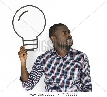 African Descent man holding light bulb