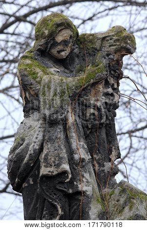 Eroded, weathered, religion, vintage cemetery tombstone sculpture.