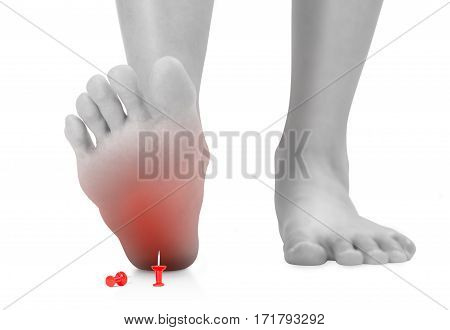 front view of woman's feet stepping on the red push pin unforeseen concept black and white color with red highlighted Isolated on white background.