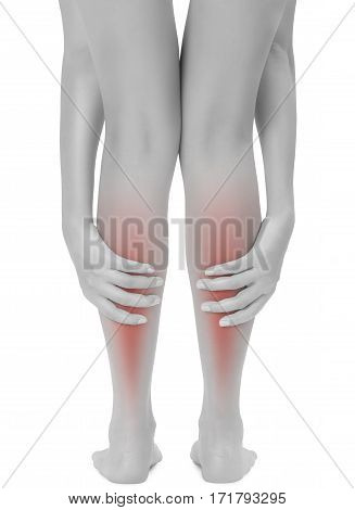 woman hands holding her beautiful healthy long leg and massaging her calf in pain area with back side black and white color with red highlighted Isolated on white background.