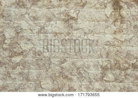 Brown granite wall background texture close up