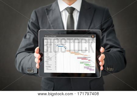 Project management software on tablet computers screen
