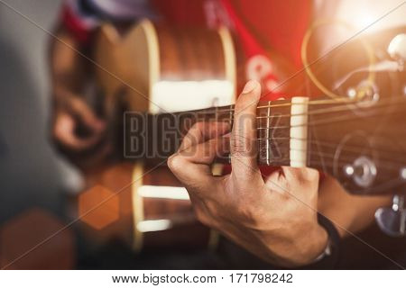 hand of man in classical guitar background