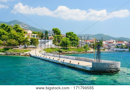 NEOS MARMARAS GREECE - AUGUST 16 2014: Old pier on waterfront in Neos Marmaras Sithonia Peninsula Greece