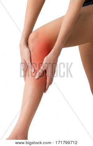 woman holding her beautiful healthy long leg with massaging shin and calf in pain area with red highlighted Isolated on white background.