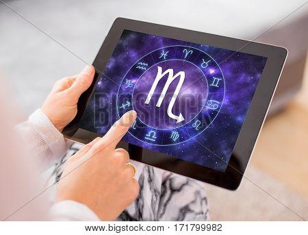 Scorpio zodiac sign on tablet computers screen