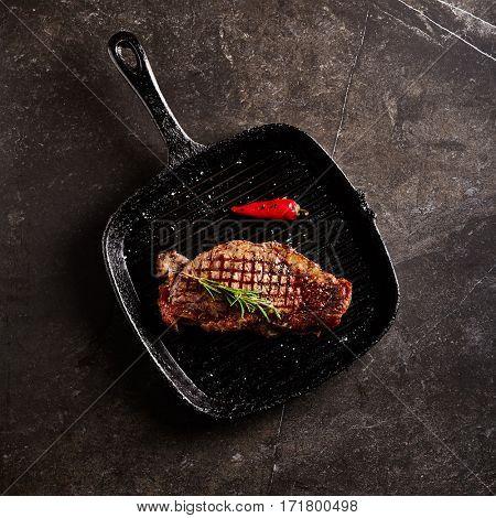 Beef Steak - BBQ Strip Steak (Grilled Beef Strip Loin Steak) on Grill Pan