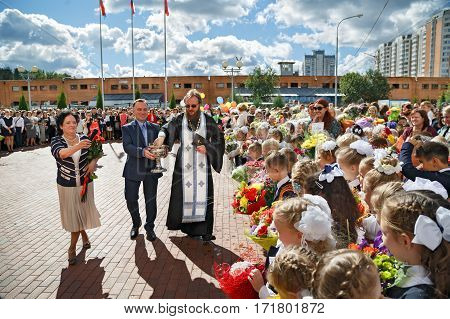 BALASHIKHA/ RUSSIA - SEPTEMBER 1. The priest sprinkles the crowd with holy water at the celebration of the beginning of the new school year on September 1, 2016 in city Balashikha, Russia.