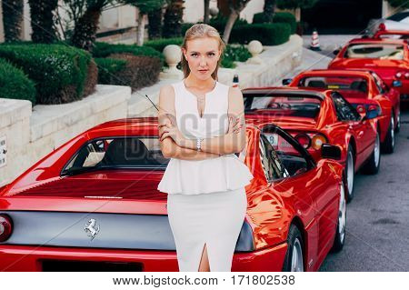 Ferrari show 8 october 2016 in Valletta Malta near Grand Hotel Excelsior. Beautiful young girl near the red Ferrari 348 TS