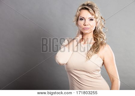 Beauty fashion people concept. Mid aged lady with dress. Female wearing amazing clothing.