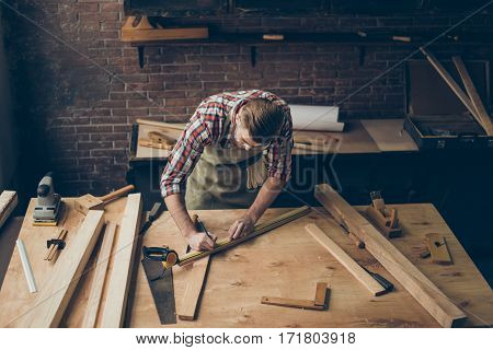 handsome joiner work in carpentry. He is successful entrepreneur at his workplace poster