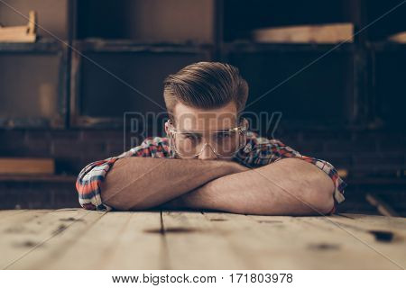 Closeup Photo Of Serious Handsome Joiner Look At Camera Near Tabletop With Tools.  Stylish Young Ent