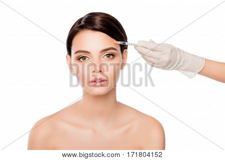 Plastic Surgery Concept. Botox Injection In Woman's Eyebrow