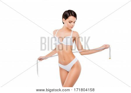Sexy Slim Woman In Lingerie With Tape Measure On White Background